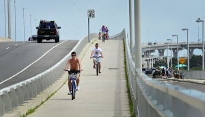 BIKING ROUTE 52: Saturday July 13 2013 People use the bike path on the Route 52 Causeway Bridge between Somers Point and Ocean City. (The Press of Atlantic City / Ben Fogletto) - Ben Fogletto