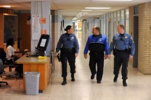 Increasing Patrols: Hamilton Township Police officer, Nicole Nelson, of Mays Landing, Oakcrest High School security officer, Robert Maldonado, of Galloway Township, and Hamilton Township Police Sgt. Greg Ciambrone, of Mays Landing, walk through the halls of Oakcrest High School at various times during the school day. Hamilton officer at Oakcrest High School, in Mays Landing. In the wake of last months Newtown, Conn. school massacre the township has stepped up patrols and is working with schools and other public facilities to ensure safety. Thursday, January, 17, 2013( Press of Atlantic City/ Danny Drake)  - Danny Drake