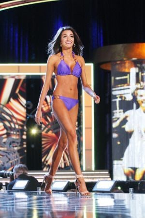 Miss America 2 PRELIMS: Miss Washington Reina Almon contestant walks the runway during swimsuit portion of the preliminary second round of the Miss America pageant at Boardwalk Hall in Atlantic City, New Jersey, September 11 2013 - Photo by Edward Lea