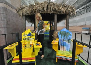 MISS AMERICA PARADE ADVANCE: Caitlin McMahon, of Atlantic City, places chairs on the Margaritaville/Land Shark Bar and Grill parade float Friday at the Atlantic City Convention Center ahead of Saturday's Miss America Show Us Your Shoes Parade. - Photo by Michael Ein