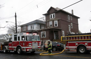 AC Fire: Firefighters gather in front of 128 N. Iowa Avenue in Atlantic City, Wednesday April 30, 2014, where a fire damaged two apartments. (Staff Photo by Michael Ein/The Press of Atlantic City) - Michael Ein