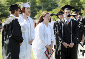 MIddle Township Graduation: From left Zach Peterson, Brinley Edwards, Caroline Seitzinger and Colin Milio, sing the National Anthem at the start of the ceremony. Middle Township High School held their 106th annual commencement ceremony on Memorial Field in Cape May Court House. Tuesday June 24, 2014. (Dale Gerhard/Press of Atlantic City) - Dale Gerhard