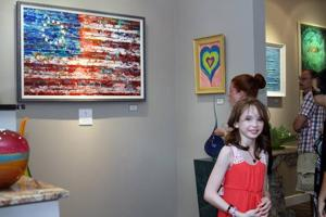 Young artist creates painting to support relief efforts for Hurricane Sandy victims