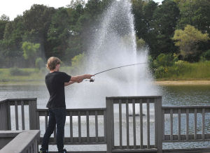 PATRIOT EFFORT : Ryan Henry, and Mark Voight, 17, of Galloway Township, fishes at Patriot Lake, Friday Sept. 13, 2013, in Galloway Township. A group of locals pooled their money to maintain the dilapidated park. (Staff Photo by Michael Ein/The Press of Atlantic City) - Michael Ein