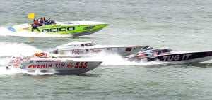 Power Boats In Atlantic City: Pushin-Tin 555, Pirate Racing 21 and Tug It 66 take the first start race off the beach in Atlantic City on June 23. - Staff Photo By Ben Fogletto