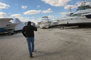 Boating Rebound: Al Mury of LEH walks through the stored boats in the yard at C-Jam Yachts in Somers Point. Tuesday April 2 2013 (The Press of Atlantic City / Ben Fogletto)  - Ben Fogletto