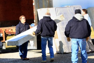 PIF FURNITURE GIVEAWAY: From left, Mark Valladares, of Tuckerton, and Frank Canale, of Egg Harbor Township, bring donated mattresses to be loaded on cars at Sandcastle Stadium, in Atlantic City, Wednesday Nov. 14, 2012, in an effort to help Atlantic City school families affected by Hurricane Sandy, coordinated by Atlantic City schools working with Cooper Levenson law firm.  - Vernon Ogrodnek