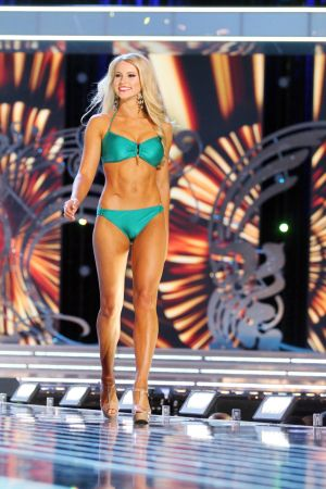Miss America 2 PRELIMS: Miss Maryland Christina Denny contestant walks the runway during swimsuit portion of the preliminary second round of the Miss America pageant at Boardwalk Hall in Atlantic City, New Jersey, September 11 2013 - Photo by Edward Lea