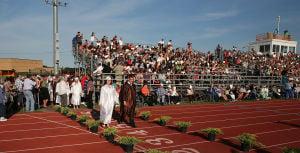Cumberland Reg Graduation: Graduates enter the athletic field for the graduation ceremony. Monday June 23 2014 Cumberland Regional High School Graduation. (The Press of Atlantic City / Ben Fogletto) - Ben Fogletto