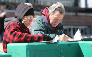 Day At The Races: Marilyn and Gary Hall of Toms River keep track of their bets between races. Sunday April 27 2014 Live turf racing at the Atlantic City Racecourse in Mays Landing. (The Press of Atlantic City / Ben Fogletto) - Ben Fogletto