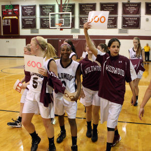 : Wildwood High School girls basketball coach Dave Troiano won his 600th career coaching victory in a win against Cape May County Technical High School. Troiano's team celebrates the win for the coach. Tuesday Jan. 29, 2013. (Dale Gerhard/Press of Atlantic City)  - Photo by Dale Gerhard