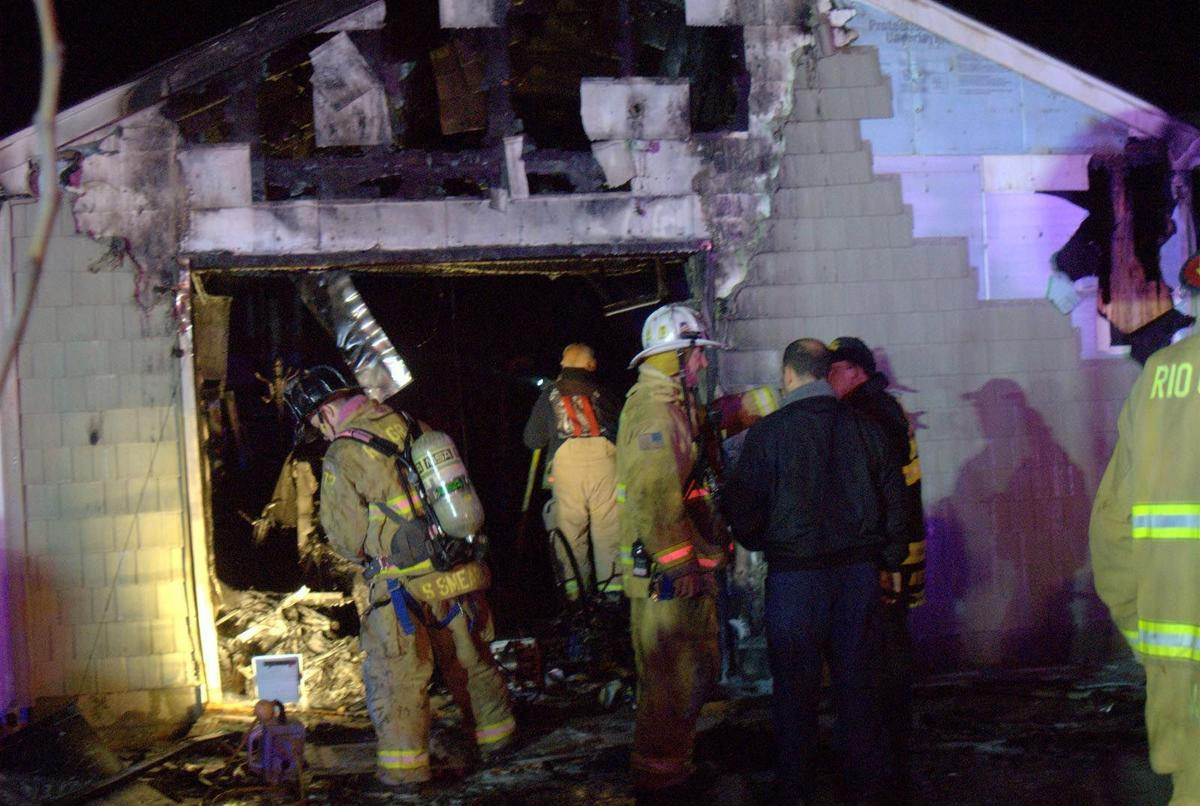 Three people escape injury in Middle house fire