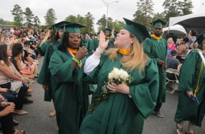 CCC GRADUATION: Cassandra Belson, of Millville, blows a kiss to a family member during Cumberland County College 2014 graduation ceremony Thursday. - Dave Griffin
