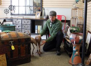 STAINTONS: Mike Zizza, of Ocean City, owner of Vintage Styles, sets up shop at Stainton's: A Gallery of Shops in Ocean City recently.  - Edward Lea