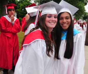 St. Joseph Graduation: Erin Doherty, 18, from Laural Springs, and Briana Hernandez, 18, from Lindenwald, pictured wait to enter the church during St. Joseph's High School Graduation held at St. Joseph Church in Hammonton. Thursday, June 6, 2013. Photo/Dave Griffin  - John David Griffin