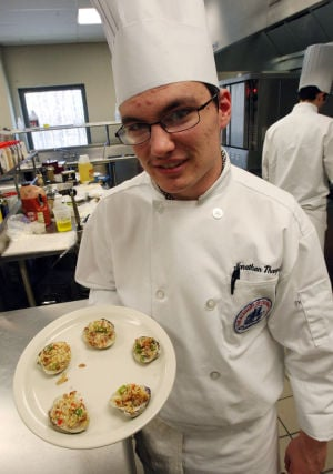 : Jon Thompson of Dennis Township, shows off his dish of clams casino he prepared for class. The Cape campus of Atlantic Cape Community College in Cape May Court House, now offers a Culinary Arts Training Program. Wednesday April 3, 2013. (Dale Gerhard/The Press of Atlantic City)  - Dale Gerhard