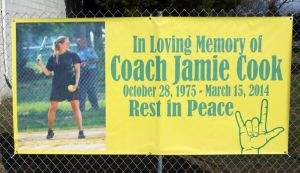 OLMA Softball: Our Lady of Marcy Academy softball team honor their former softball coach Jamie Cook who died suddenly over the winter at a young age Tuesday, April 8, 2014. - Edward Lea