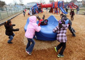 Recess: Students at Cape May Elementary School take recess before lunch on Tuesday.  - Dale Gerhard