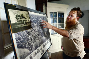 Somers Mansion: Caretaker John Morsa of Galloway points to a depiction of Somers Point and a photo from the 1920's displayed in the downstairs room. Sunday July 14 2013 Somers Mansion in Somers Point. (The Press of Atlantic City / Ben Fogletto) - Ben Fogletto
