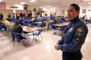 Increasing Patrols: Hamilton Township Police officer, Nicole Nelson, of Mays Landing, in the cafeteria during a lunch period at Oakcrest High School, in Mays Landing. In the wake of last months Newtown, Conn. school massacre the township has stepped up patrols and is working with schools and other public facilities to ensure safety. Thursday, January, 17, 2013( Press of Atlantic City/ Danny Drake)  - Danny Drake