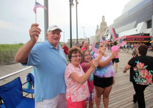 AC Salutes Armed Forces Parade: From left, Everett Schwarzenbach, his wife, Patricia, both of Egg Harbor City, with niece Julia Lehneis, of Galloway, and Alivia Rivera, of Fleetwood, PA, at , the Atlantic City Salute Armed Forces parade on the Atlantic City Boardwalk, Monday June 24, 2013  - Vernon Ogrodnek