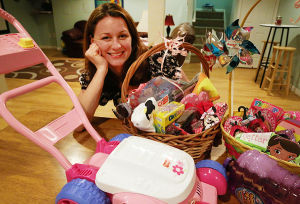 Easter Baskets: Monday April 14 2014 Katie Agresta, 33, of Egg Harbor Township, fills her children's Easter Baskets with non-candy toys as well as traditional candies. (The Press of Atlantic City / Ben Fogletto) - Ben Fogletto