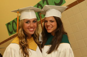 OLMA GRADUATION: Bridget Dandrea, 18, left, of Longport and her cousin Ali Dandrea, 18, right, of Vineland pose during Our Lady of Mercy Academy's graduation on Tuesday.  - Photo by Edward Lea