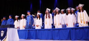 Cumberland Christian Graduation: Graduates stand on stage during graduation. Friday June 13 2014 Cumberland Christian School Graduation. (The Press of Atlantic City / Ben Fogletto) - Ben Fogletto