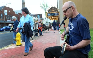 Main Street Millville1: Street musician Ronnie Tomasello of Millville plays on the corner of High Street and Pine in Millville.  - Ben Fogletto