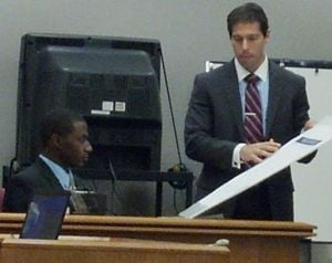 Trial Of Pleasantville Home Invasion: Tyree Kelly, left, testifies at the murder trial of his friend Jeremiah Jackson. Assistant Prosecutor Seth Levy shows him a record of texts between Kelly and Jackson.  - Photo by Lynda Cohen