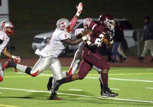 Pleasantville Falls To Vineland: Pleasantville's Kendelle Williams foreground scores a touchdown against Vineland's Benjamin Anderson (9) and Chris Atoki at Pleasantville High School on Friday. - Edward Lea