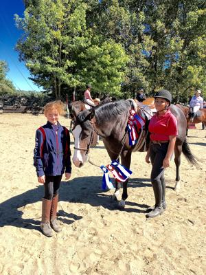 <p>Zoe Gruendig (left), 10, of Bethlehem and Karizma Nowell, 13, of Naugatuck each won many ribbons aboard quarter horse mare Just Terrific.</p>