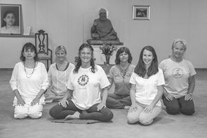"<p class=""p1""><strong>Instructor Diane Scuteri (left), Board Member Jean Bielucyzk, Director and Instructor Janaki Pierson, Manager Jackie Sicard and Instructors Sara Van Doren and Hilde Brehm sit in front of the murti at the Woodbury Yoga Center, which represents Shri Dhyanyogi. He was Ms. Pierson's spiritual teacher and an inspirational force behind the founding of the center.</strong></p>"