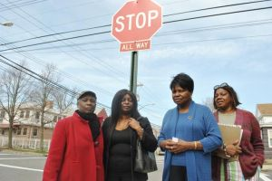 <p>Fay Hill, left, Allison Stoby, Doris Bathersfield and Mitzie Geohagan of Springfield Gardens say four-way stop signs have eliminated accidents at the previously perilous intersection of 181st Street and 145th Drive.</p>