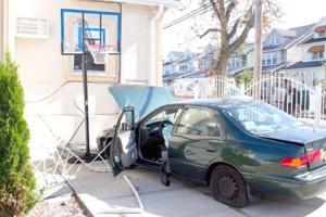 Car slams into Jamaica home 1