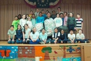 PS 97 fifth-graders pitch in 1
