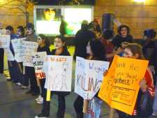Protesters rally in front of Qns. Center