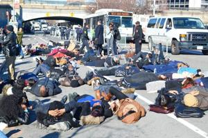 "<p>About 150 people, mostly York College students, staged a ""die-in"" on Guy R. Brewer Boulevard on Monday to protest recent grand jury decisions in the deaths of Eric Garner in Staten Island and Michael Brown in Missouri.</p>"