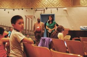 <p>Jennifer Valdez, a speech language pathologist at PS 17, at mike, spoke to a crowd of about 60 parents and students of how more children could negatively affect students who need extra help.</p>