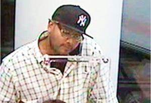 Serial bank robber wanted in Queens 1