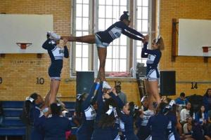 Cheerleaders light the way at Bowne 1