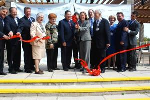 <p>Borough President Melinda Katz snips the ribbon alongside Plaza College President Charles Callahan and various elected officials at the 98-year-old school's opening ceremony for its new Forest Hills campus on Friday.</p>