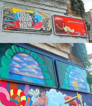 Muralist covers illegal billboards 1