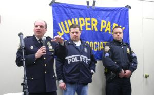 <p>During a briefing at the 104th Precinct, Capt. Christopher Manson, left, seen speaking at last week's Juniper Park Civic Association meeting with two other officers, announced the capture of an alleged mass robber targeting Ridgewood over the last two weeks.</p>