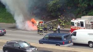 Van erupts into flames on Grand Central Pkwy 1