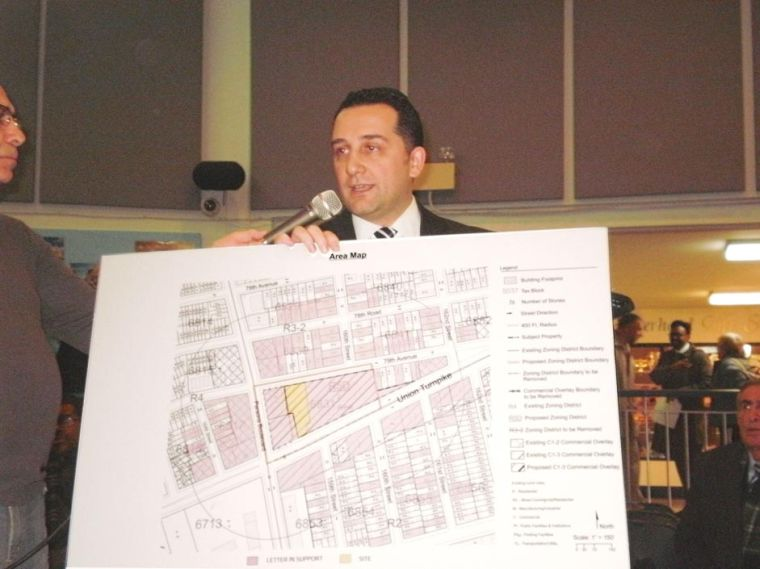 CB 8 approves smaller building 1