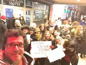 "<p>Members of the WomenHelpingWomen of Forest Hills hold up signs supporting the Cinemart Cinemas last Thursday. The Forest Hills theater was in danger of closing, but the high number of tickets purchased by concerned residents for the new war flick ""American Sniper"" are helping keep it afloat for now.</p>"