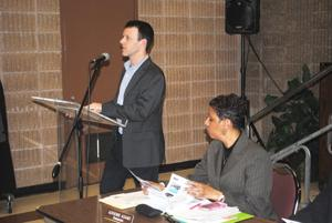 <p>Justin Wood of New York Lawyers for the Public Interest last week sought support for a bill capping community trash handling capacity at a meeting of Community Board 12. Transfer stations in CB 12's area handle the third-highest amount of trash in the city.</p>