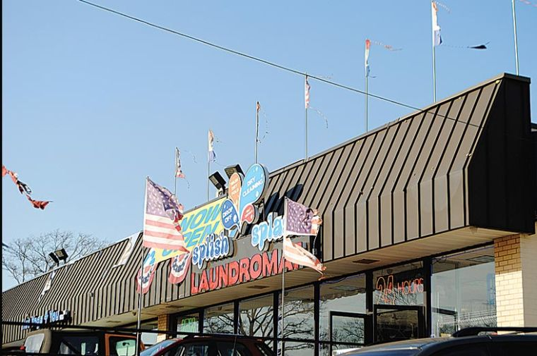 Torn flags to be taken down from storefront 1
