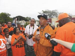 Marchers decry violence, seek change 1